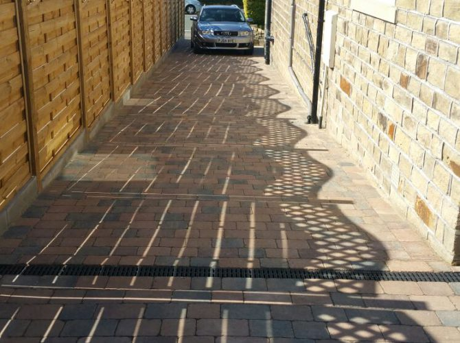 Block paving and fence