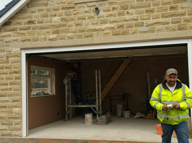 Stone garage with door open